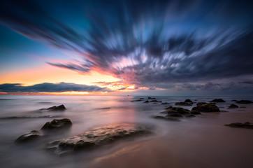 Amazing sea sunrise with slow shutter