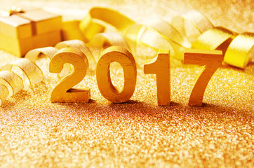 Fototapete - Closeup gold wood 2017 with Gift and ribbon and lighting effect on white background, New year decoration, copy space.