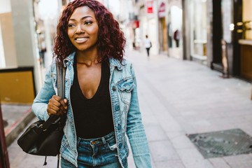 Pretty young woman walking in the street.