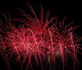 Red fireworks on black background at international competition i