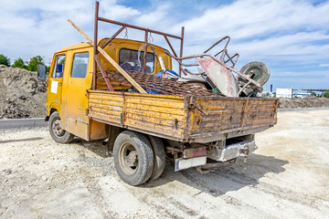 Small truck loaded with inventory from building site