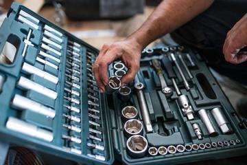 Mechanic tidying up tools