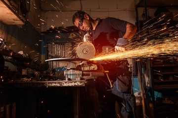 worker using an angle grinder
