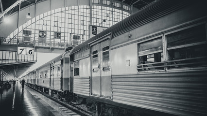 Arrival train at railway station or train station with structure and roof in Bangkok, Thailand.