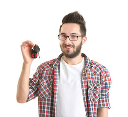 Portrait of young man holding car key, isolated on white