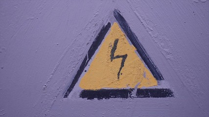 sign of the lightning current triangle gently on a gray wall