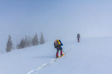 touristic group walking through a winter hills