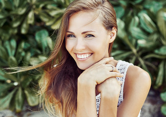 Close up portrait of attractive caucasian smiling woman
