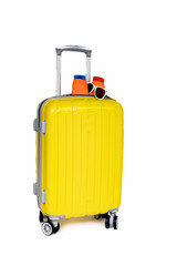 Travel yellow bag and cosmetics on white background.