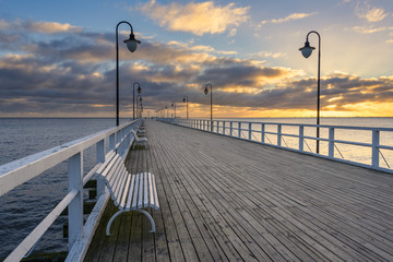 Wooden pier in Gdynia Orlowo in the morning. Sunrise time. Poland. Europe.