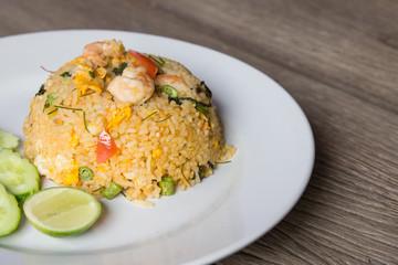 Shrimp fried rice on wood floor