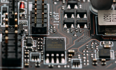 transistors capacitors resistors and other electronic components mounted on motherboard(macro) closeup.selective focus