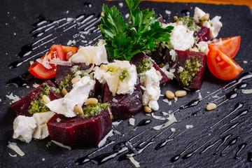 beet salad with garlic, top view, closeup