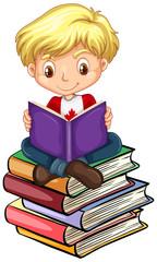 Canadian boy reading books