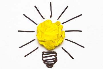 Inspiration concept crumpled paper light bulb metaphor