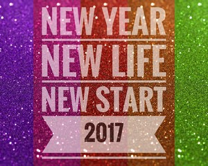 Happy new year 2017 words on shiny colorful glitter background