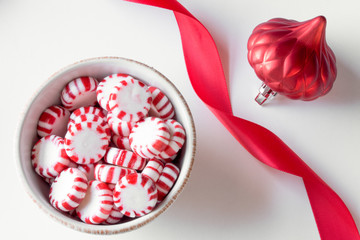 Hard peppermint candies with red ribbon and ornament
