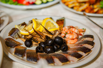 smoked fish with olives