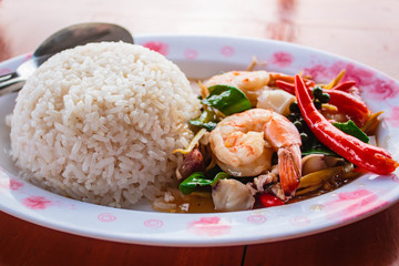 Fried spicy seafood and rice.