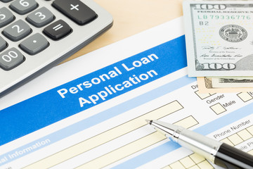 Personal loan application form with calculator, dollar money, an