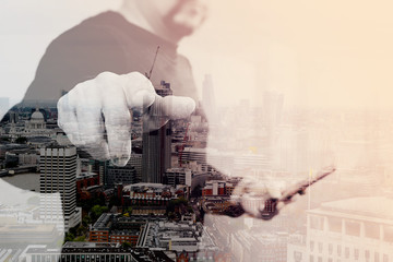 Double exposure of Businessman hand pressing an imaginary button