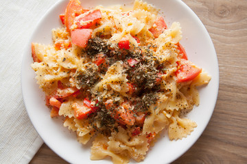farfalle with tomatoes and italian cheese parmesan on plate