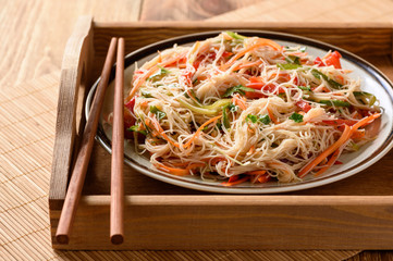 Asian salad with rice knoodles and vegetables.