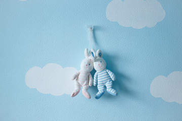 romantic couple of lovers rabbits toy against the wall of clouds and sky