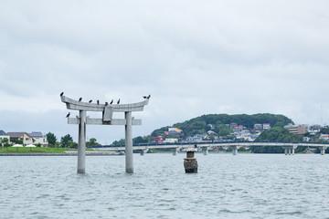 Stone torii with water in Fukuoka city