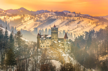 Wall Mural - Sunset light over medieval dracula Bran castle in winter season, Brasov, Transylvania,  Romania