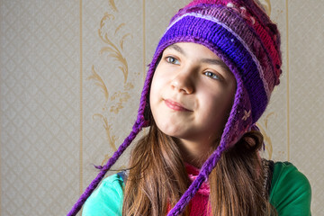 Close up portrait of a 11 year old girl in a knitted cap