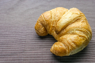 croissant on woonden plate
