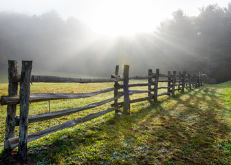 Sun Rays in Foggy Field and Split Rail Fence