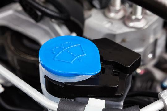 Car engine windshield washer fluid reservoir cap close-up