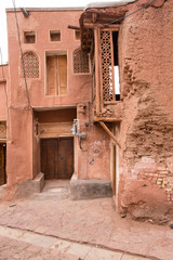 The tipical red mud-brick houses in the ancient village of Abyan, in Iran
