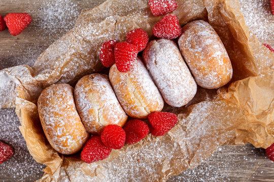 Fresh Raspberry jam doughnuts in icing sugar