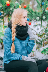 Beautiful blonde girl braids braid, knitted sweater, Winter magic day, the effect retro photo, grain