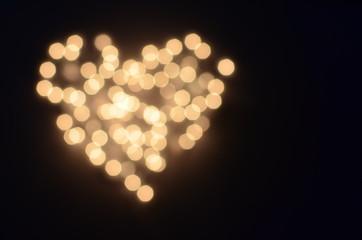 Bokeh lights background in a heart shape