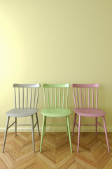 Three simple chair in empty room.
