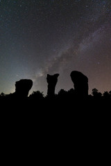 Silhouette stonehenge and milky way on background.Long exposure shooting and high iso used make this photo have noise