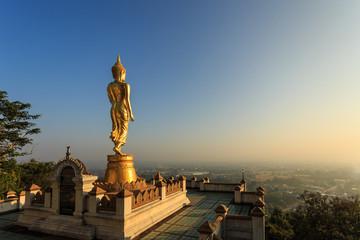 Golden buddha statue in Thai temple, Wat Phra That Khao Noi in N