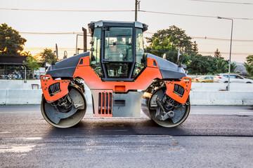 road roller working on the new asphalt road