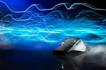 High technology computer gaming mouse in dark blue tone with stroke of lightning as background