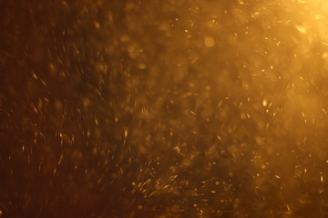 Abstract Snowstorm texture. Falling snow. Light flashes and bokeh. Sun rays. Lens flare. For use as...