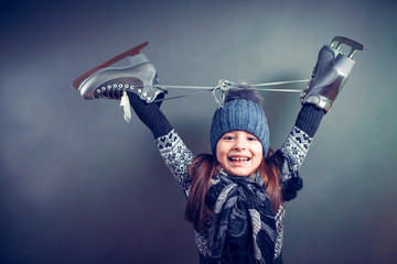 Little girl with skates isolated on background