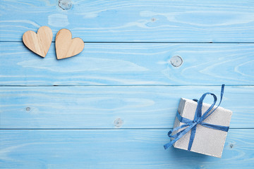 Composition of gift on blue wooden background