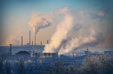 Smoking stack from lignite combined heat and power plant plant (Pilsen). Digital artwork on air pollution and climate change theme. Power and fuel generation in Czech Republic, European Union.