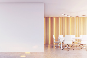 Meeting room with light wooden panels, toned