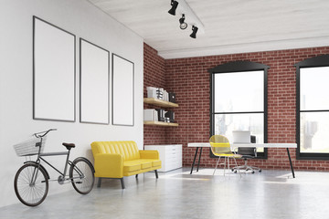 Home office: yellow chair, three posters side view