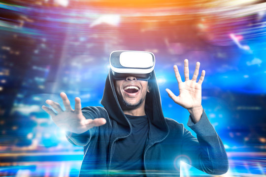 African American man in vr glasses playing game